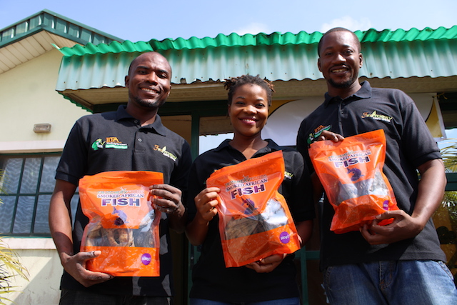 Agriprenuers-Oni-Hammed-Ngozi-Okeke-and-Yusuf-Babatunde-directors-of-Frotchery-Farms-Limited-who-are-graduates-of-the-IITA-Youth-Agriprenuers-programme-outside-their-factory-in-Ibadan-Nigeria-credit-Busani-Bafana