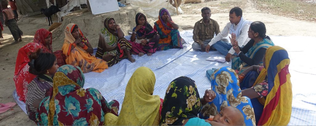 Community-awareness-session-in-progress-with-trafficking-survivor-Devendra-Kumar-Mulayam-1024x408