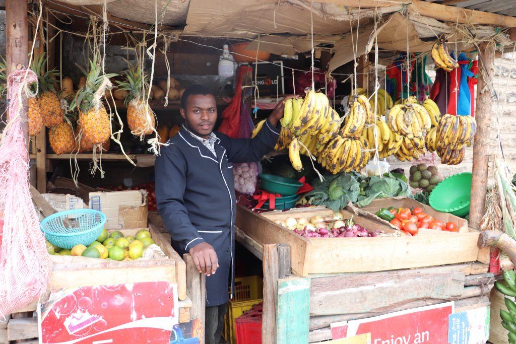 Joseph-Lowasa-Baraka-in-his-vegetable-and-fruit-kiosk-in-Nairobi-1-1024x683